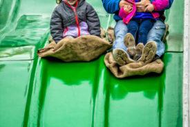 A Family Having fun on the 90 foot mega fun slide at Bengtson Fall Festival
