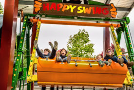 kids having fun on happy swing