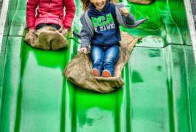 Kids Having Fun on the 90 Foot long Mega Fun Slide at Bengtson Pumpkin Patch
