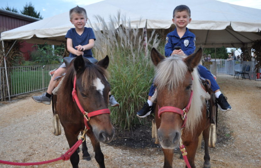two boys on a pony ride