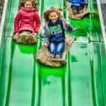 Kids on a slide at Bengtson Farm